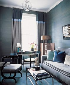 blue grasscloth wallpaper blue room velvet sofa two tone curtains