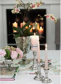 Pretty pink candles.....love the candle light in the fireplace