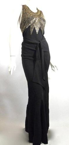 1930s black crepe rayon bias cut evening gown with deco beading, criss cross back.