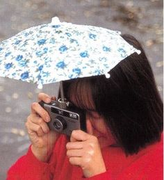 Camera Rain Umbrella . genius. especially with living in seattle. don't know how many cameras I've ruined from them getting rained on.