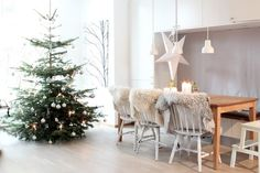 cute scandinavian christmas dining room decorating ideas with silver christmas tree furry rug chair chover and white interior: nordic christmas tree Scandinavian Christmas Decorations, Scandi Christmas, Decoration Christmas, Christmas Interiors, Scandinavian Home, Christmas Home, White Christmas, Christmas Design, Modern Christmas
