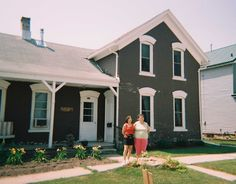 Sissy-Chris & me in front of our old family home in Kewaunee, WI