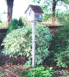 Bird house made from old porch post. Tin can roof.