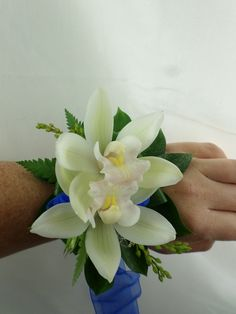 Ball corsage using beautiful orchids and blue ribbon. Created by florist ilene