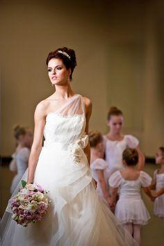 We love this updo! Photo by Edmonson Weddings. www.wedsociety.com  #wedding #beauty