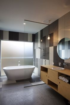 Bathroom. Brown Vujcich House, by Bossley Architects. Herne Bay, New Zealand.