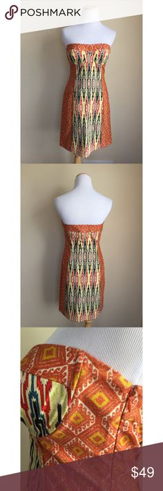 """Rachel by Rachel Roy strapless dress sz 6 Rachel by Rachel Roy tribal and medallion print strapless dress, size 6.  Canvas-like material, padded cups with underwire, side zip and hook closure, fitted sheath style, please review measurements for fit.  Condition:  excellent pre-loved.  Material:  100% cotton.  Measurements (approximate, taken laying flat):  length 27"""", flat top band 15.5"""", flat waist 14.25"""", flat hip 17.25"""".  This will not work for curvy/large bustlines. RACHEL Rachel Roy…"""