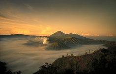 The cinder cones of Mt Bromo (smoking) and Mt Semaru (in background) on the island of Java, Indonesia.
