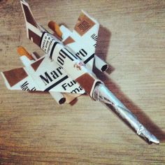 A combat plance made of a cigarette pack.