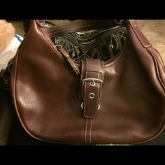 Burgundy Hobo Handbag (Authentic) The leather exterior and the fabric interior are both in excellent condition, with little to no signs of use. The item pictured is the item you will receive. Please inspect all pictures closely for additional description of condition. Coach Bags Satchels