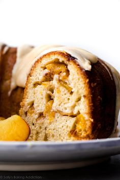 Super moist peach bundt cake with cinnamon soaked peaches and delicious brown butter icing on top! Recipe on sallysbakingaddiction.com
