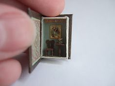 Tiny book with even smaller miniature scene hidden inside it.