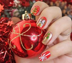 Classy and elegant looking red themed Christmas nail art. Design your nails with Christmas ribbons and bells in glitter polish. Not only does it look beautiful but it gives an elegant feel to your nails.