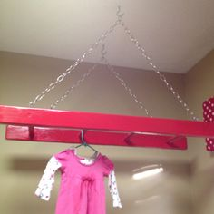 DIY clothes rack for laundry room! Painted wooden ladder and chain
