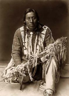 a Piegan Indian with his Medicine Pipe. It was made in 1910 by Edward S. Curtis.