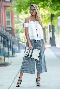summer outfit, night out outfit, party outfit, street chic style, summer trends 2016 - white cold shoulder top, plaid culottes, black lace up heels, black stripe clutch, round mirror sunglasses