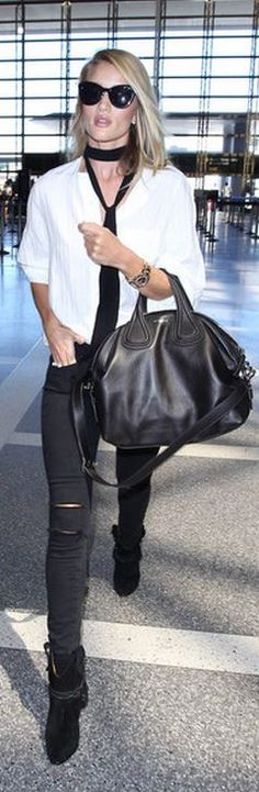 Who made  Rosie Huntington-Whiteley's black leather handbag, watch, suede boots, ripped skinny jeans, and white top?
