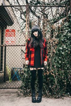 Jag Lever: Red and Black Checked Jacket + Grey Beanie + Dark Eyeliner + Black Dress + Black Thigh Highs / Over-the-Knee Socks + Garters (?) + Black Boots | Simple Urban Grunge