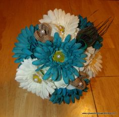 Bridesmaid round bouquet with peacock feathers and burlap flowers from www.silkweddingflowersforless.com