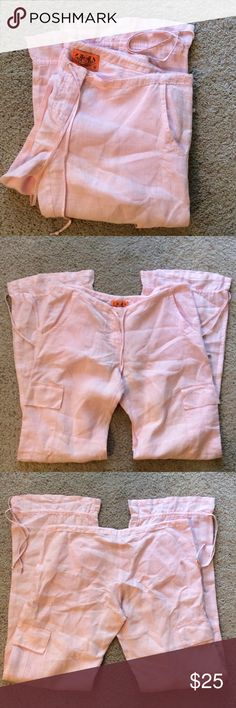 """Juicy Couture pink linen pants. Size S. Like new condition. Super cute 100% linen drawstring pants. Drawstrings at the ankles too. Size small, but measures 36"""" with the waist completely open, an 8"""" rise and about a 34"""" inseam. Machine washable. Juicy Couture Pants"""