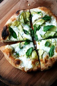 This zucchini anchovy pizza has a subtle flavor of anchovy, melting summer squash, creamy burrata, and fresh basil. Yum.