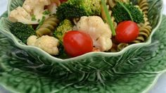 For a deliciously festive salad toss cooked pasta with bite-sized bits of broccoli and cauliflower, chopped tomatoes, chives and crabmeat. Then pour your favorite Italian dressing over the whole thing and chill, baby!