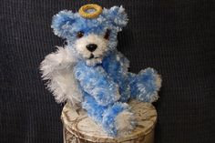 This is Azure, my first Gurdian Angel Bear!  She stands 10 inches tall.  Azure's head, arms and legs are movable.  Azure, her halo and her wings are all crocheted.   Do you know of someone who needs a Guardian Angel?