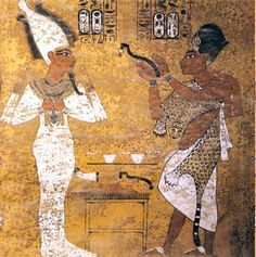 Ay performing the Opening of the Mouth ritual on the dead pharaoh. - Scene from Tutankhamun's tomb.