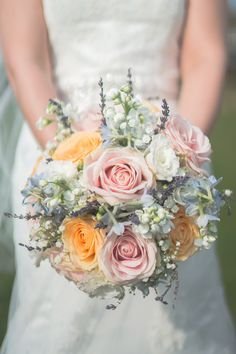 pretty bouquet of sweet avalanche blush roses, peach roses, lavender, gypsophila, blue delphinium and white lisianthus for a kirkley hall wedding. image by steven mcdonald photography. flowers by fleur couture