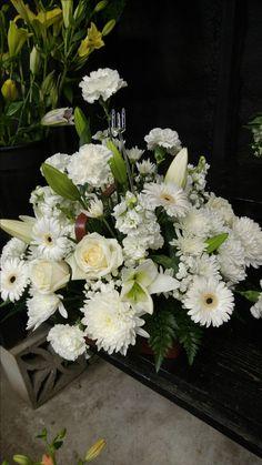 Magnificent white arrangement for the wedding ceremony. americasflorist.com