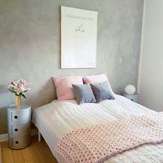Minimalist bedroom with feminine touches in Denmark.
