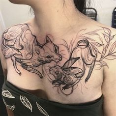 Fox and rabbit chest tattoo