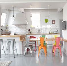 I love the pop of color with the chairs.... yes, I could have this kitchen.