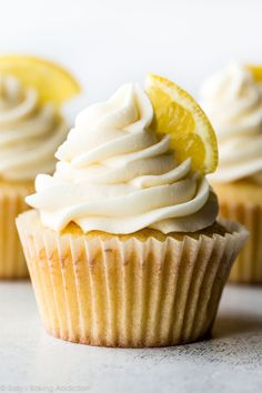 These sunshine sweet homemade lemon cupcakes with vanilla frosting are incredibly soft and bursting with lemon flavor! Recipe on sallysbakingaddiction.com