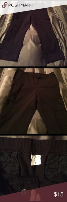 Motherhood maternity large black Capri pants Size large black maternity Capri pants. Cinch back to give room for belly. Super cute and comfortable material and great for work or casual. Size cargo pockets and backs detail along with cuffed bottoms. From motherhood. Motherhood Maternity Pants Capris