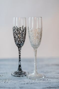 For these glasses color: white and black All completely handmade! MEASUREMENTS: -Champagne flutes : Height - 9.2 inch (23.5 sm). Volume – 170ml (6.1 oz)  Custom champagne glasses may be created to fit your needs. Your unique wedding colors can be used for this design. Names and date may be painted to customize to your occasion. Glasses will be carefully packed for shipping. Also, here you can order a guest book, ring pillow, unity candle set and many other.  for the manufacture of your order…
