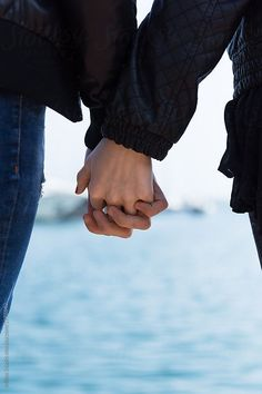 Crop loving people holding hands by Milles Studio for Stocksy United. Crop shot of man and woman holding hands gently standing on seascape. Hand Photography, Couple Photography, Fire And The Flood, People Holding Hands, Wattpad Book Covers, Couple Hands, Love People, Couple Pictures, Couple Goals