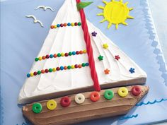 Have the little ones help you decorate a Sailboat Cake!