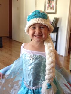 Happy little girl wearing the Elsa hat I made for her.
