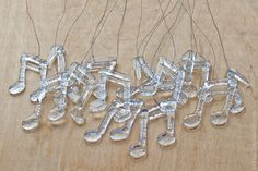 Sweet simple clear glass notes. What cute mini ornaments these would be!