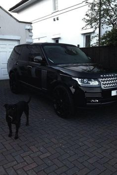Home/Family - I plan to have a black on black Land Rover Range Rover as well. And a dog to match. Range Rover Negro, Range Rover Schwarz, Range Rover Black, Rolls Royce, Dream Cars, My Dream Car, Supercars, Porsche, Bmw Autos