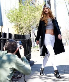 Back to the day job: Nina Agdal was back doing what she does best as she shot a new fashion campaign on the streets of Brooklyn, New York City, on Wednesday