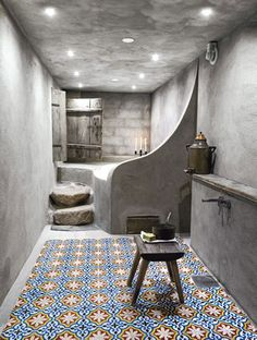 Log Cabin bathroom - Dalarna, Sweden. Love the use of concrete with moroccan tiles. I adore the idea of steps up to a bath - giving the feel of a sunken bath.