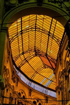 Bucharest through the lens of Photgrapher Emanuel Ailenei Pasajul Macca-Villacrosse, Bucharest A fork-shaped, yellow glass covered arcaded street in central Bucharest, Romania. Câmpineanu Inn (Romanian: Hanul Câmpineanu) once stood in the place nowadays occupied by the passage.