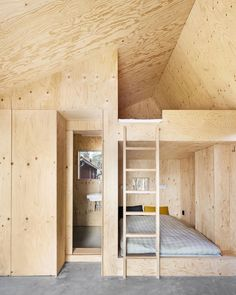 Lookofsky outfitted the bedroom with built-in pine plywood bunkbeds, walls, and a ceiling. The bathroom and a closet are also wrapped in plywood. Plywood House, Plywood Walls, Pine Plywood, Plywood Sheets, Plywood Interior, Built In Bunks, Red Houses, Concrete Floors, Architecture