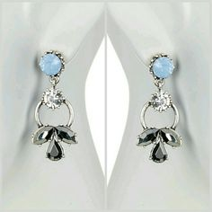 🎄🎄Betsey Johnson Earrings 🎄🎄 oh Shiny!! icy blue with accent crystals...large enough to make a statement. Silvertone prong set faceted glass and plastic Stone drop earrings post back 1 .2 inch length material silver tone base metal glass plastic Jewelry Earrings