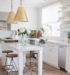White and gold kitchen. - THE DESIGN OF THIS KITCHEN IS SO SENSIBLE & MAKES USE OF EVERY LITTLE SPACE!!