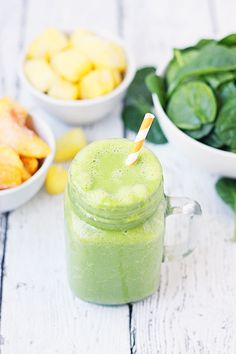 Pineapple Peach Green Smoothie -- This pineapple peach green smoothie is packed with good-for-you ingredients and good-for-your-taste-buds flavor. Frozen pineapple and peaches make it sweet while spinach and protein make it extra healthy! | halfscratched #ad #smoothie #recipe #drink