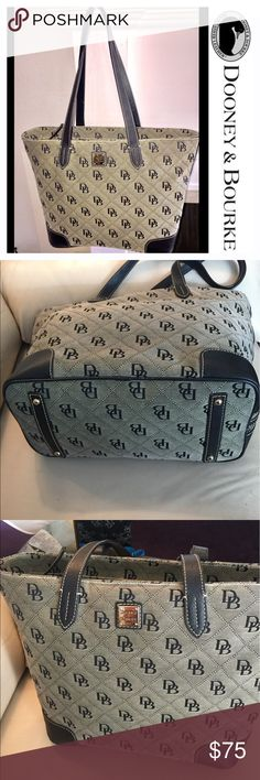 Dooney & Burke Extra Large Signature Jacquard Tote Preowned. Weekender bag. Good Condition. Etched with D&B black monogram in a top quality woven jacquard gray canvas. Black leather trim with attractive Gold tone hardware. One side zip pocket & four inside pockets. Zipper closure. The bag has frayed edges near strap. Inside lining with some ink stained marks. Dooney & Bourke Bags Totes