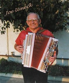"""The late Joe Umeck Jr. of the """"Fontana Button Accordion Club"""". Playing on button box and chromatic accordions for more than 60 years,  Umeck advanced the cause of Cleveland-Style Polkas across the nation. Joe led his own orchestra in Girard, OH from 1936 to 1966. A pioneer in the button-box revolution, Joe organized the Chicago Slovene Button Box Club in 1970, making three recordings and leading tours to Slovenia. Moving to California in 1977, Joe revamped the Fontana Slovene Button Box…"""
